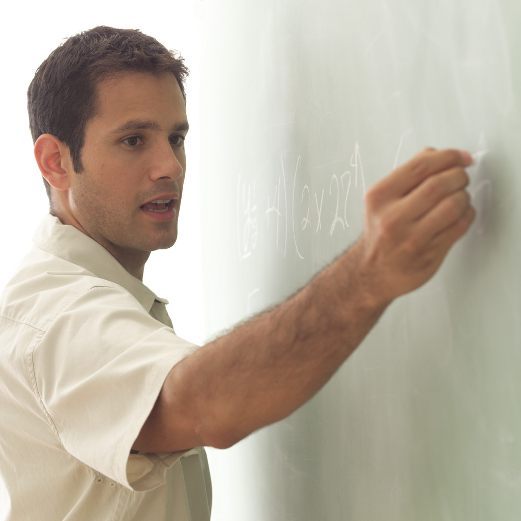Math Teacher Writing on Chalk Board