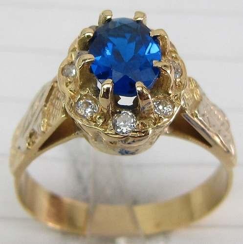 Anel de ouro 18 com Safira azul