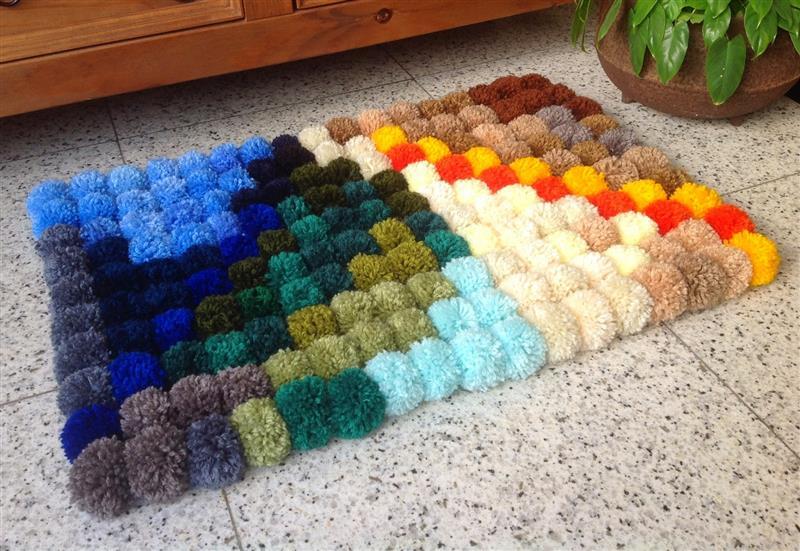 tapete de pompons de lã