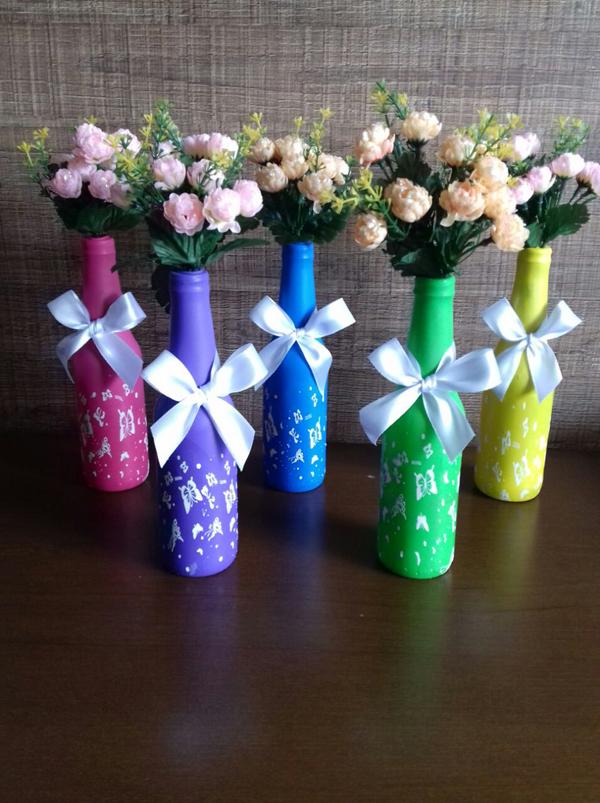 garrafa de vidro com rosas