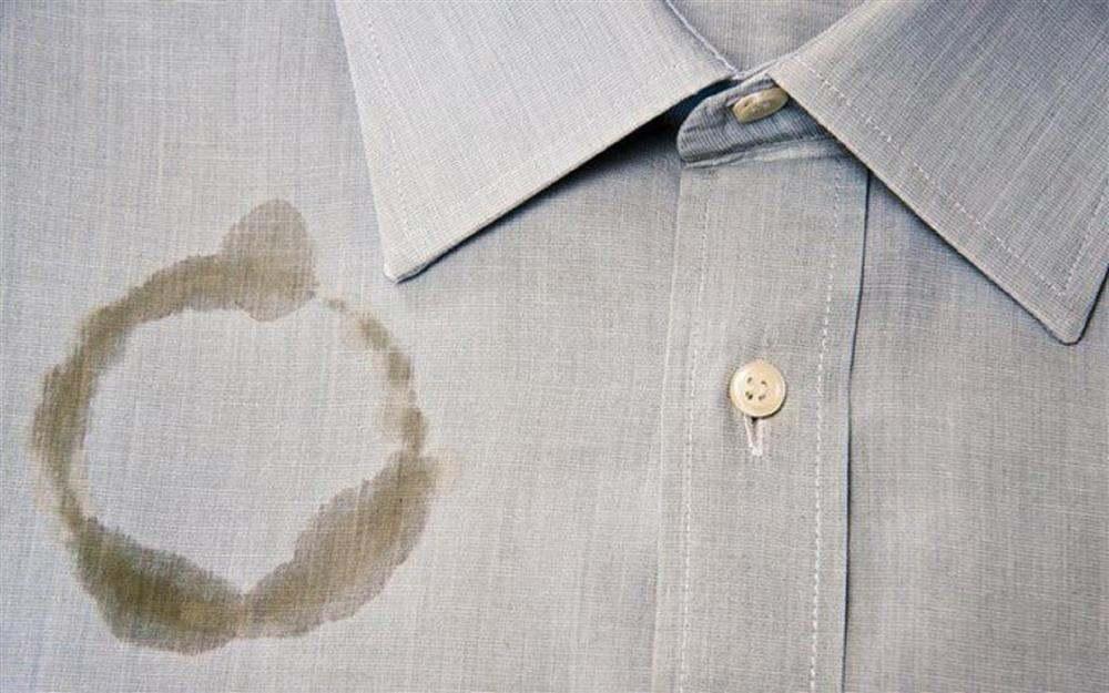 como tirar mancha de óleo da roupa depois de lavada